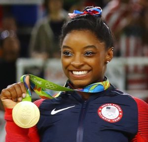 Simone Biles poses with her gold medal after USA won gold the women's team final in Rio de Janeiro on August 9, 2016. Photo courtesy of REUTERS/Mike Blake *Editors: This photo may only be republished with RNS-OLYMPICS-BILES, originally transmitted on August 10, 2016.